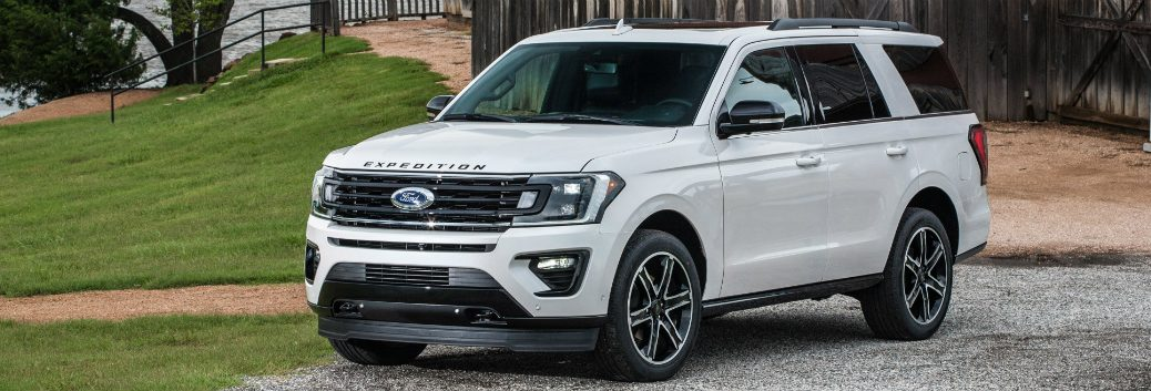 White 2019 Ford Expedition parked in front of a barn