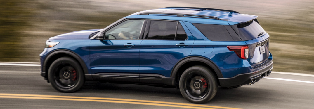 Side View Of Blue 2020 Ford Explorer St Driving On A Highway
