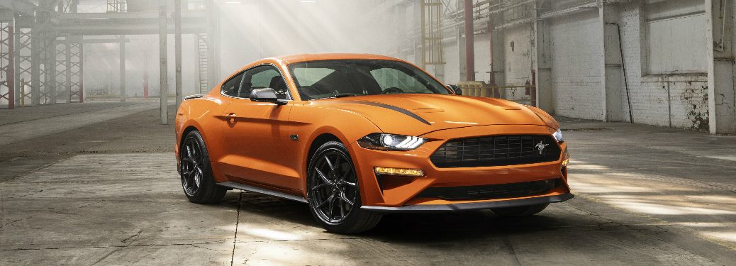 Passenger's side front angle view of orange 2020 Ford Mustang 2.3L High Performance Package