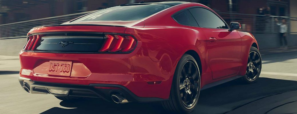Passenger's side rear angle view of Red 2019 Ford Mustang