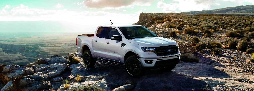White 2019 Ford Ranger with the Black Appearance Package parked near the edge of a cliff