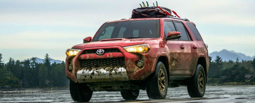 New Changes to the 2016 Toyota 4Runner Design at Allan Nott Toyota-Lima OH-Fort Wayne IN-New Toyota Dealer-Mud-Covered 2016 Toyota 4Runner Red Exterior with Cargo