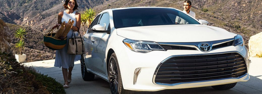 drive and passenger getting into 2018 Toyota Avalon