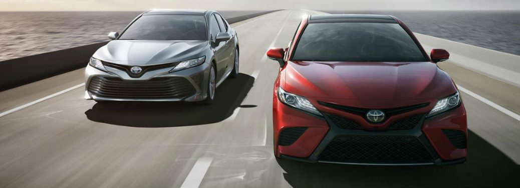 two 2018 Toyota Camrys driving down the road