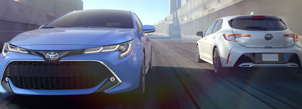 two 2019 Toyota Corolla Hatchback models driving