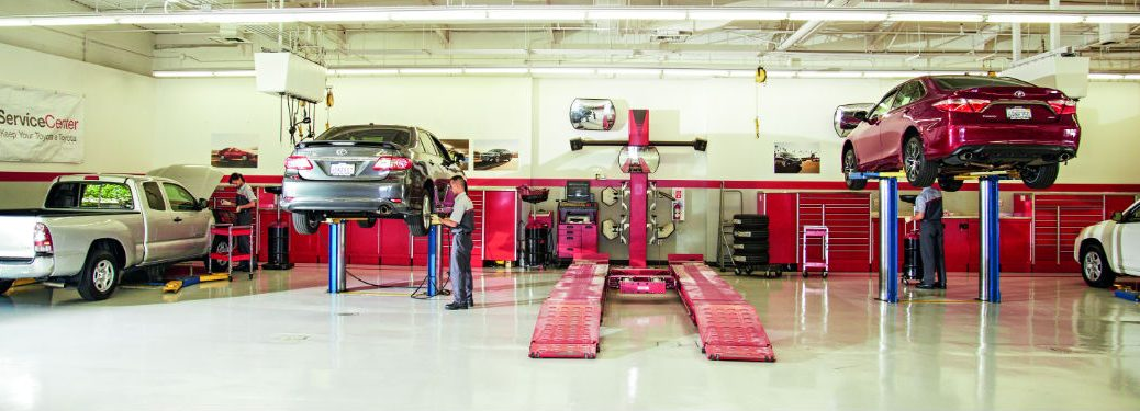 Genuine Toyota Service near Lima, OH with image of Toyota models in a Toyota service center