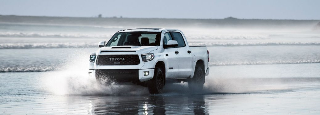 2019 Toyota Tundra Color Options with image of a 2019 Toyota Tundra TRD Pro CrewMax in Super White driving through water