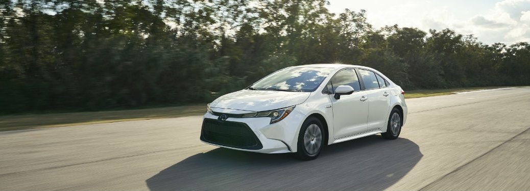 2020 Toyota Corolla Hybrid Release Date with image of the 2020 Toyota Corolla Hybrid driving on a sunny road