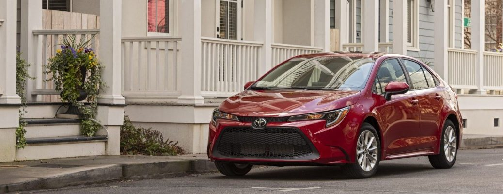 Red 2020 Toyota Corolla parked outside a Southern-style home