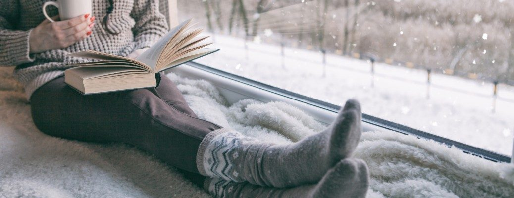 Woman reading a book during the winter season