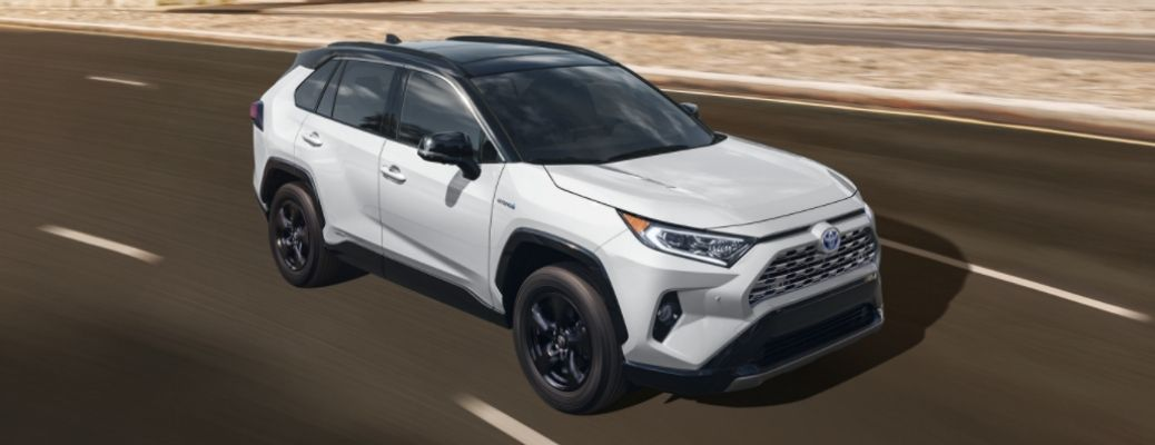 White 2021 Toyota RAV4 on a road. What are the safety features of the 2021 Toyota RAV4?