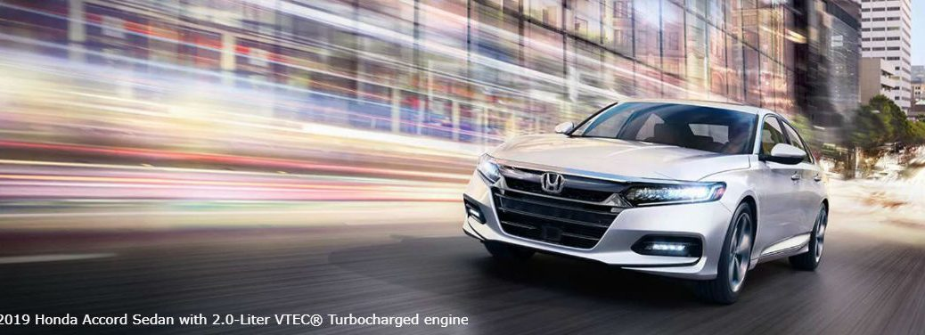 2019 Honda Accord Exterior Color Options with image of a 2019 Honda Accord Sedan with a 2.0-liter VTEC® Turbocharged engine driving fast in a city