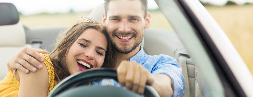 Loving couple on a road trip in a car