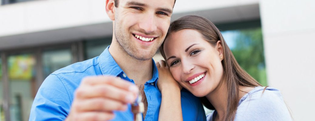 Couple with the set of keys to a new car