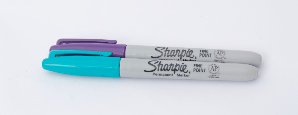 Blue and purple Sharpie markers