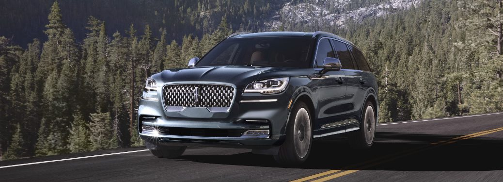 Blue 2020 Lincoln Aviator driving on a mountainous road
