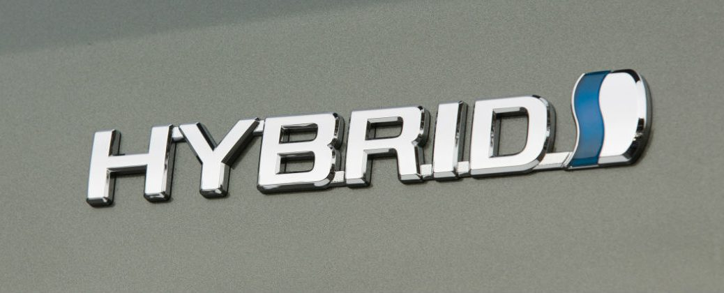 Toyota Hybrid Badge in Sliver on Silver Vehicle