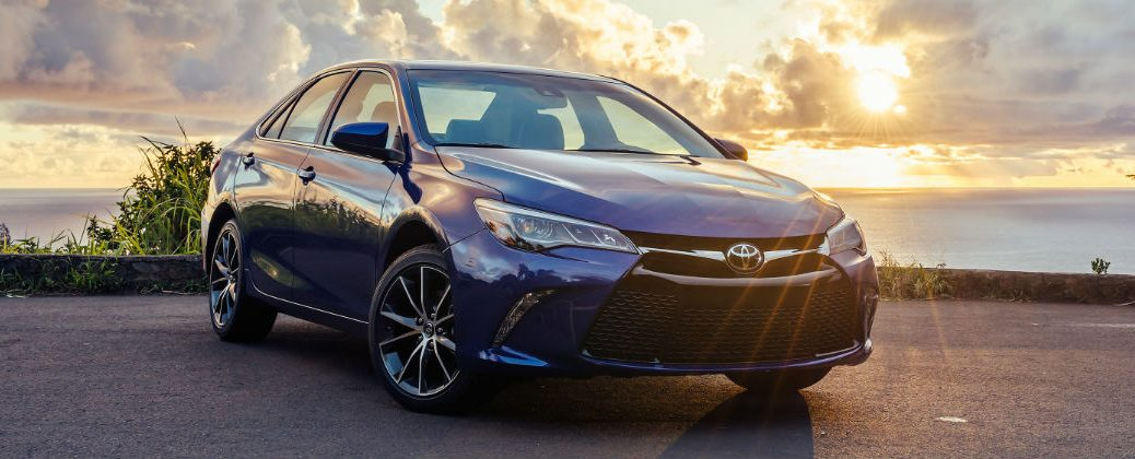 Blue 2017 Toyota Camry Front Exterior With Sunset In Background