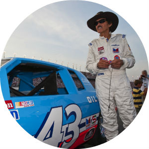 Richard Petty Standing Next to #43 Stock Car before a race