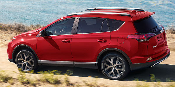 Red 2017 Toyota Rav4 Driving On Coast Highway