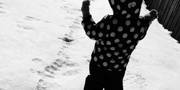 Photo of small child in snow