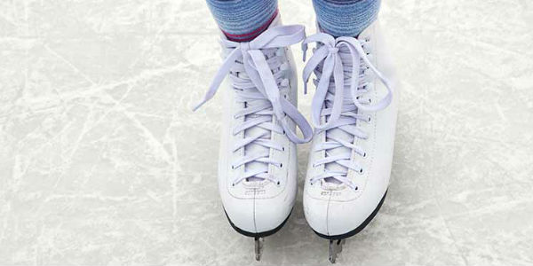 Close up of ice skates on a child's feet
