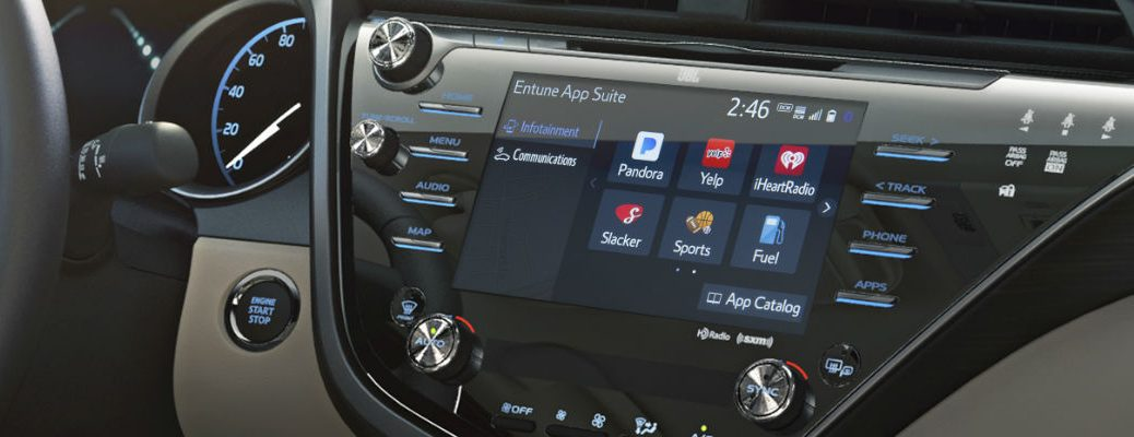 Toyota Camry dashboard with touchscreen featuring Toyota Entune 3.0. What is Toyota Entune 3.0?