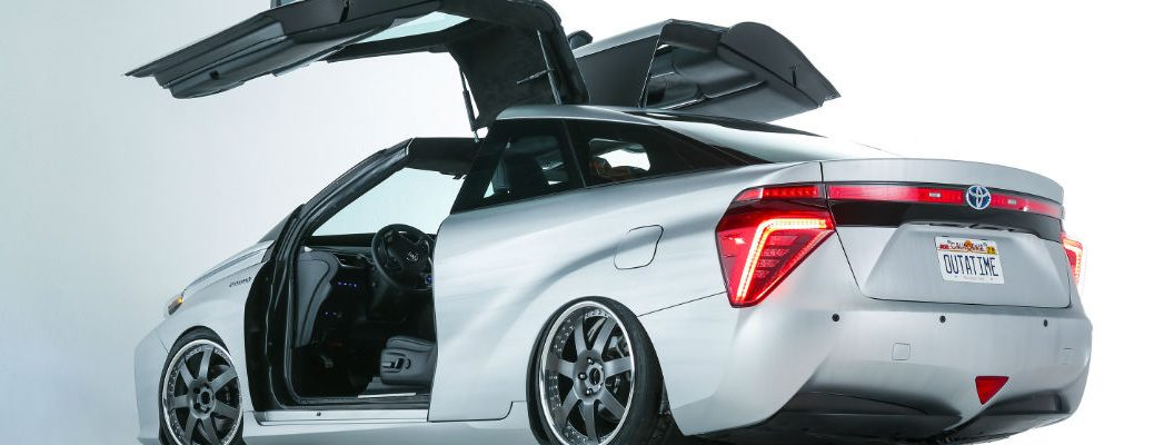 A whiite Toyota Mira fuel cell vehicle with gull-wing doors was a 2015 SEMA show vehicle from Toyota