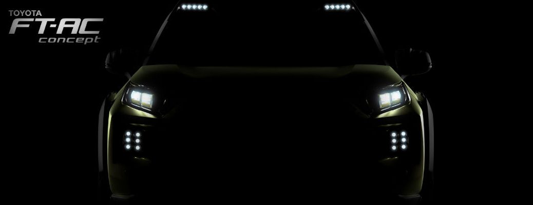 A heavily silhouetted photo of a new Toyota concept SUV debuting at the LA Auto Show