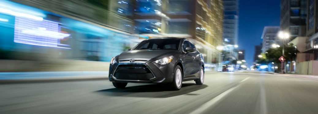 2018 Toyota Yaris iA driving on the road.