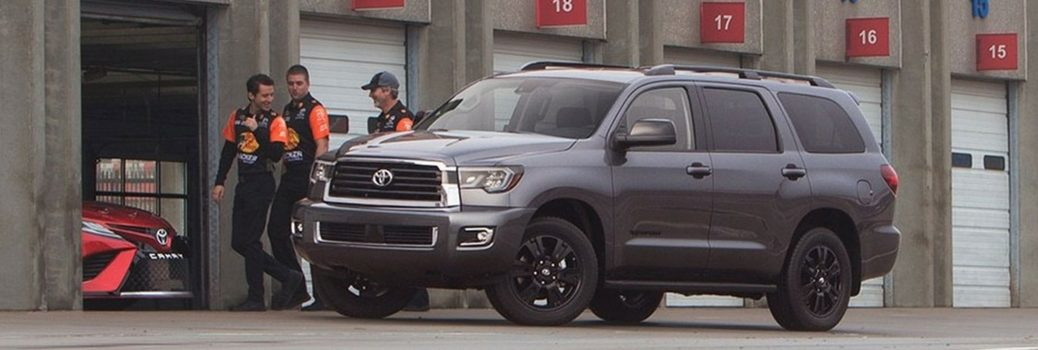2018 Toyota Sequoia parked outside warehouse