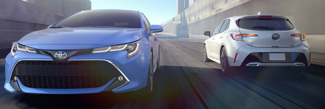 2019 Toyota Corolla Hatchback driving down the road