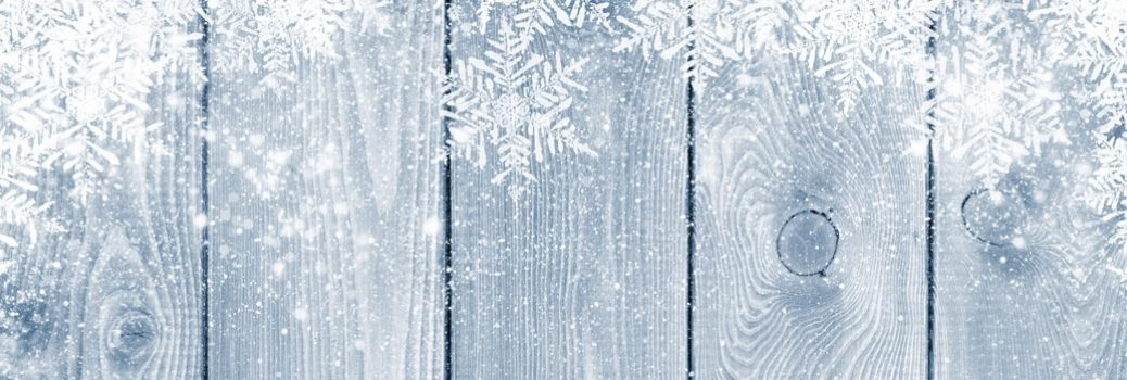 Wooden board that has been winter decorated.