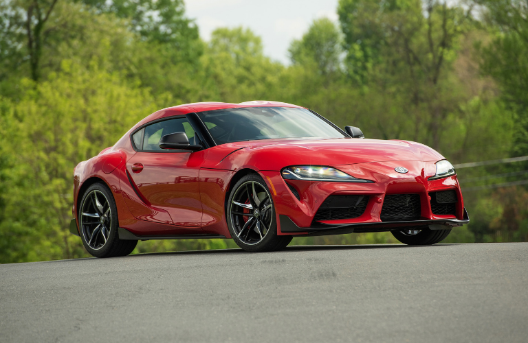 New Toyota Supra red on the road