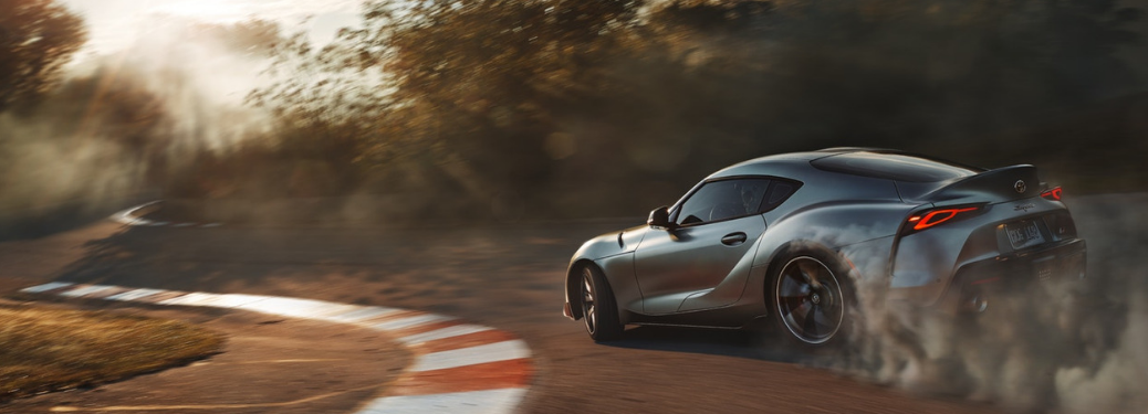 2020 Toyota Supra driving on track
