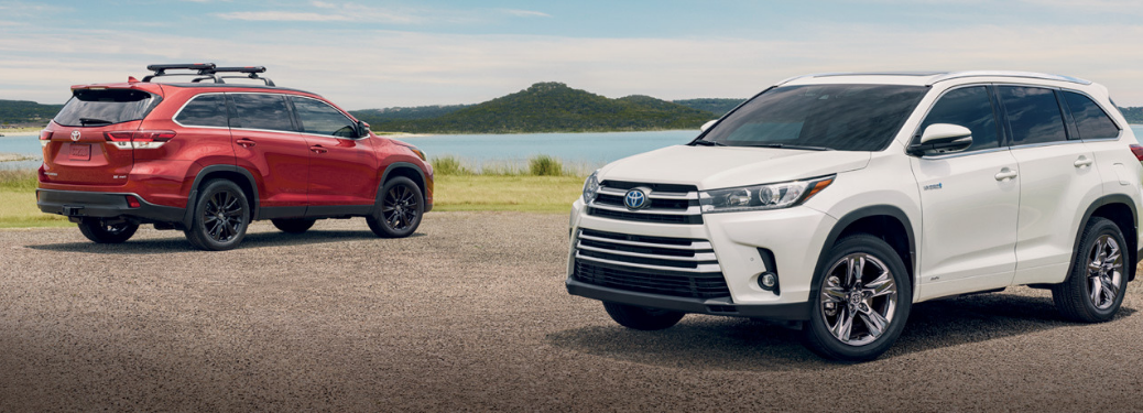 Two 2019 Toyota Highlanders parked outside