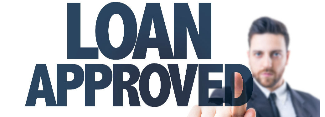 "Man pressing the words ""Loan Approved"""