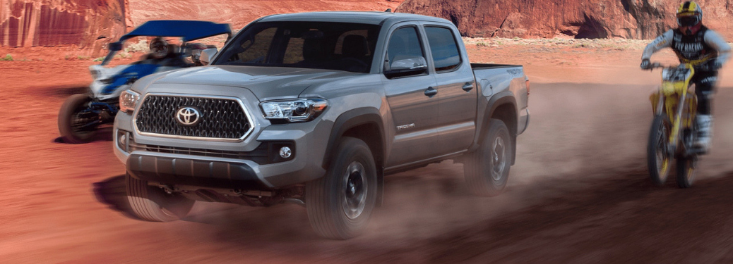 2019 Toyota Tacoma driving with ATV and Dirtbike