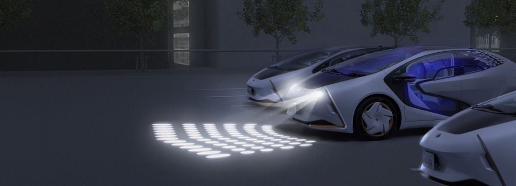 Toyota LQ Concept parked outside with lights on