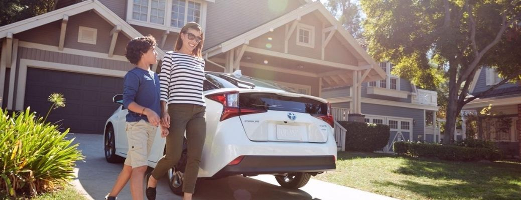 2020 Toyota Prius parked outside with family