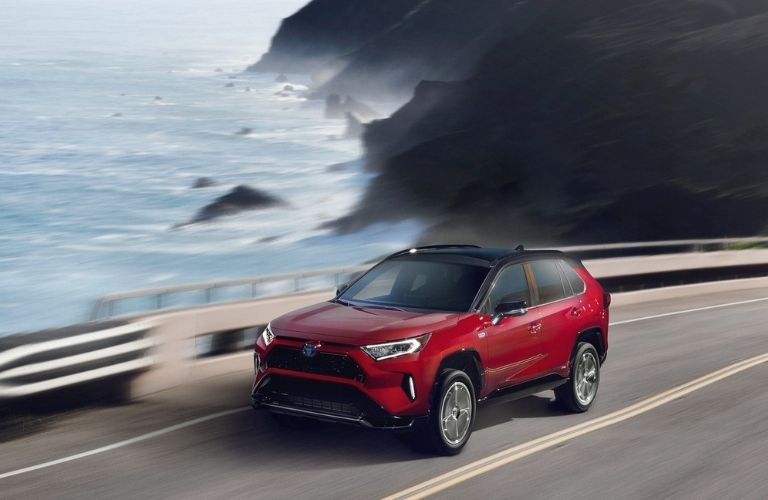 2021 Toyota RAV4 Prime driving front view on road