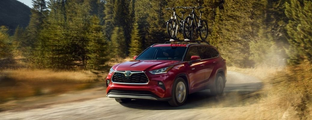 2021 Toyota Highlander driving on a dirt road