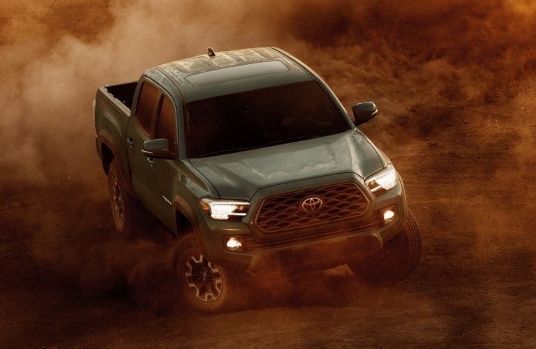 2021 Toyota Tacoma driving in sand_