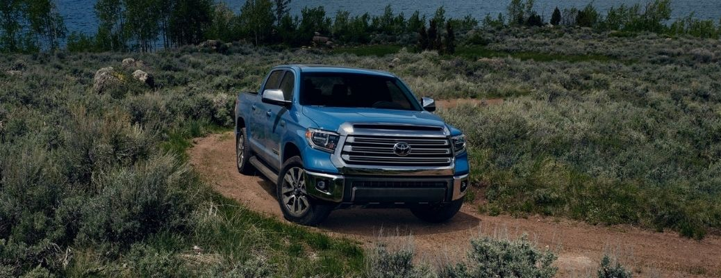 2021 Toyota Tundra parked by the lake with greenery on both sides