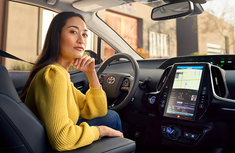 A lady sitting inside the 2022 Toyota Prius