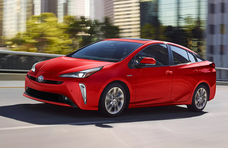 A red 2022 Toyota Prius on the road