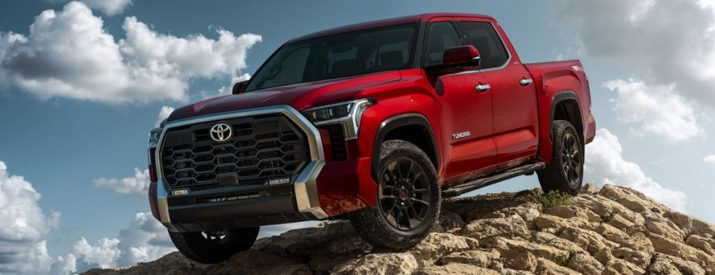 A red 2022 Toyota Tundra on a rocky terrain.