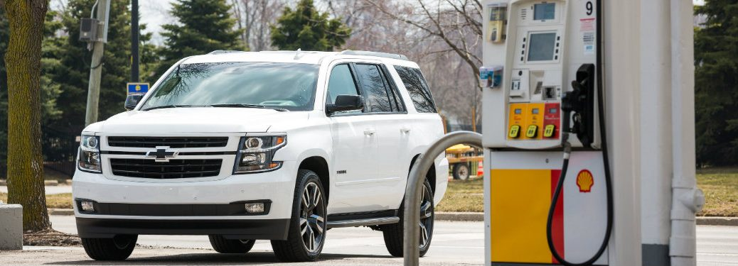 2018 Chevy Tahoe parked by a Shell gas pump