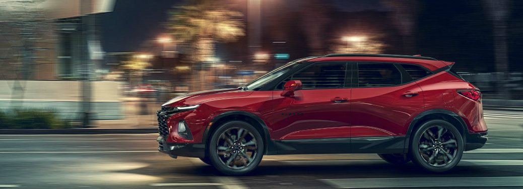 side view of the 2019 Chevy Blazer driving in the city
