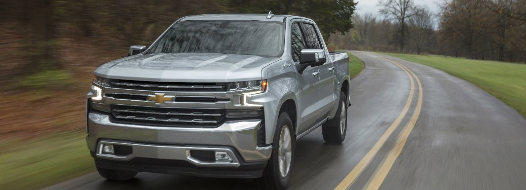 silver 2019 Chevy Silverado 1500 on the road
